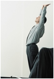 Man Stretching at the Office