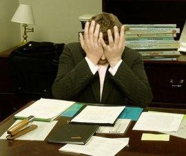Tense man at desk