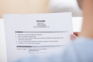 Person Holding Resume